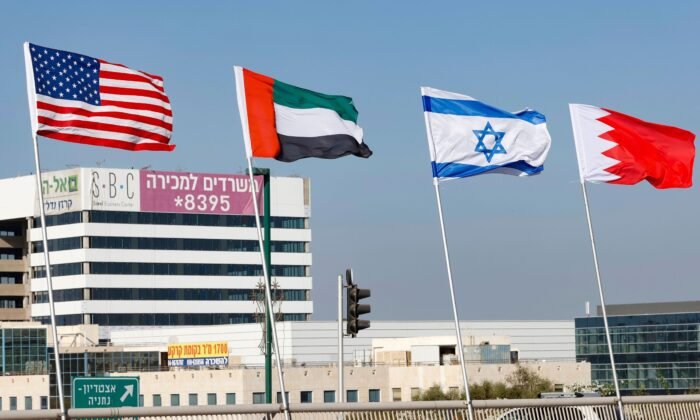 (L-R) The flags of the United States, the United Arab Emirates, Israel, and Bahrain are flown along a road in Netanya, Israel, on Sept. 13, 2020, ahead of the signing of the Abraham Accords Peace Agreement at the White House on Sept. 15. (Jack Guez/AFP via Getty Images)