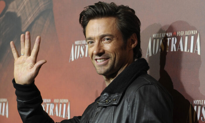 """Australian actor Hugh Jackman poses for photographers during the photocall for the film """"Australia"""" on December 12, 2008 in Berlin. (Michael Kappeler/DDP/AFP via Getty Images)"""