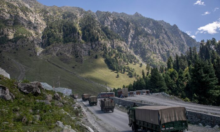 An Indian army convoy moves on the Srinagar-Ladakh highway at Gagangeer, northeast of Srinagar, in Indian-controlled Kashmir, India, on Sept. 9, 2020. (Dar Yasin/AP Photo)