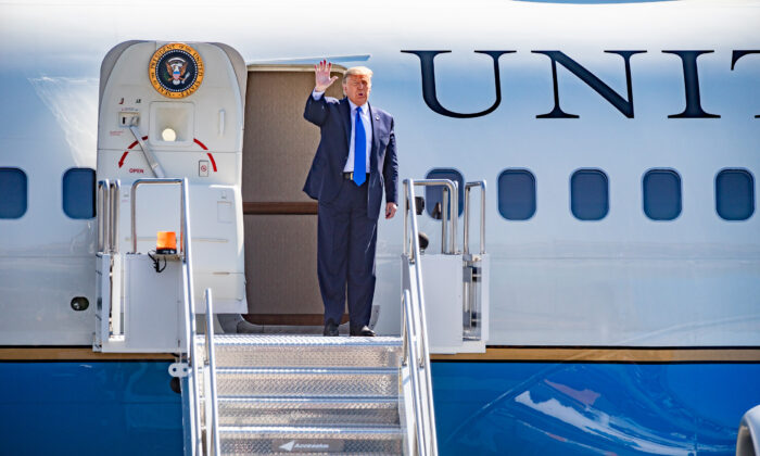 President Donald Trump greets cheering supporters at John Wayne Airport in Santa Ana, Calif., on Oct. 18, 2020. (John Fredricks/The Epoch Times)