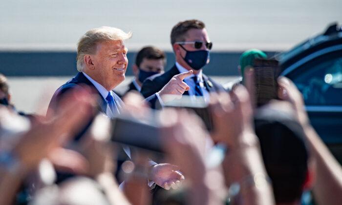 President Donald Trump greets cheering supporters at John Wayne Airport in Santa Ana, Calif., on October 18, 2020. (John Fredricks/The Epoch Times)