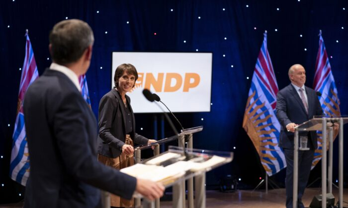 (L-R) Liberal Leader Andrew Wilkinson, Green Leader Sonia Furstenau, NDP Leader John Horgan, before the start of the election debate at the Chan Centre in Vancouver on Oct. 13, 2020. (The Canadian Press/Jonathan Hayward)