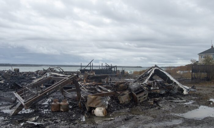 Tensions remain high over an Indigenous-led lobster fishery that has been the source of conflict. Debris from a burnt out fish plant is scattered along the shore in Middle West Pubnico, N.S., Canada on Oct. 17, 2020. (The Canadian Press/Andrew Vaughan)