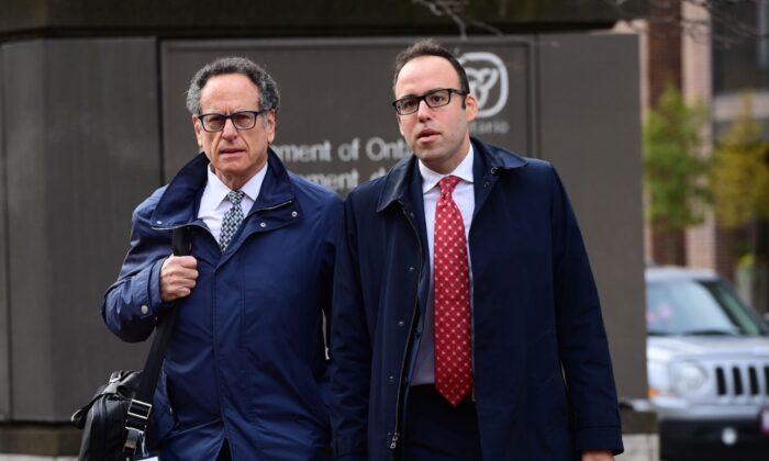 Defence lawyers Michael Edelson and Solomon Friedman (left) arrives at court in Ottawa on Oct. 20, 2020 as Ontario Court Justice Robert Kelly is set to present his verdict in the case of Const. Daniel Montsion, who has pleaded not guilty to manslaughter, aggravated assault and assault with a weapon in the death of Abdirahman Abdi. (The Canadian Press/Sean Kilpatrick)