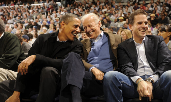 Hunter Biden with then-President Barack Obama and Vice President Joe Biden during a college basketball game at the Verizon Center in Washington on Jan. 30, 2010. (Mitchell Layton/Getty Images)