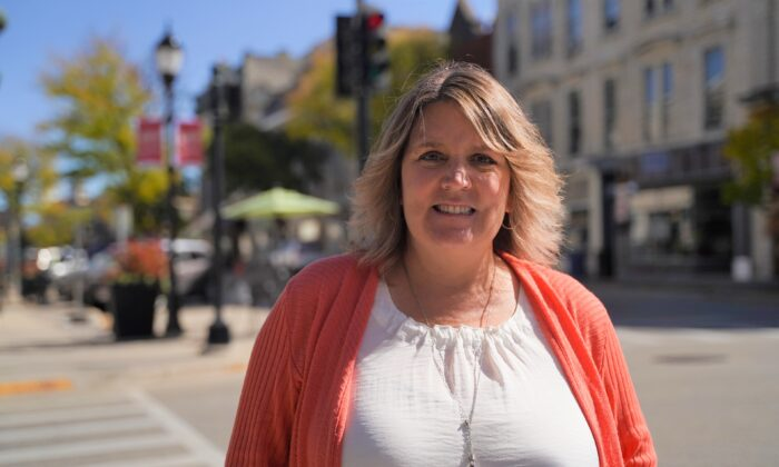 Kris Owens stands in downtown Waukesha, Wis., on Oct. 7, 2020. (Cara Ding/The Epoch Times)
