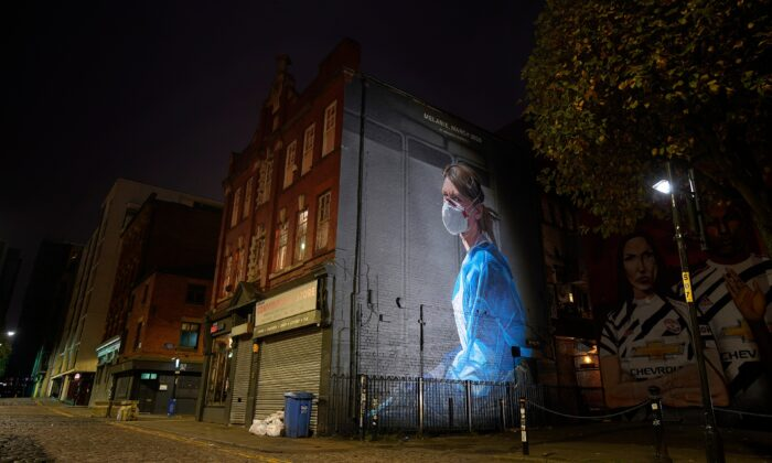 A mural depicting NHS nurse Melanie Senior in Manchester's Northern Quarter on Oct. 19, 2020.  (Christopher Furlong/Getty Images)