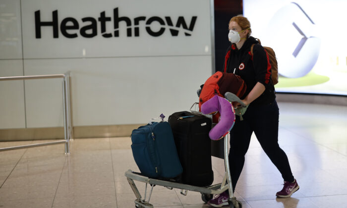 In this file image a passenger arrives at Terminal 2 of Heathrow airport, west London on May 22, 2020. (Tolga Akmen/AFP via Getty Images)