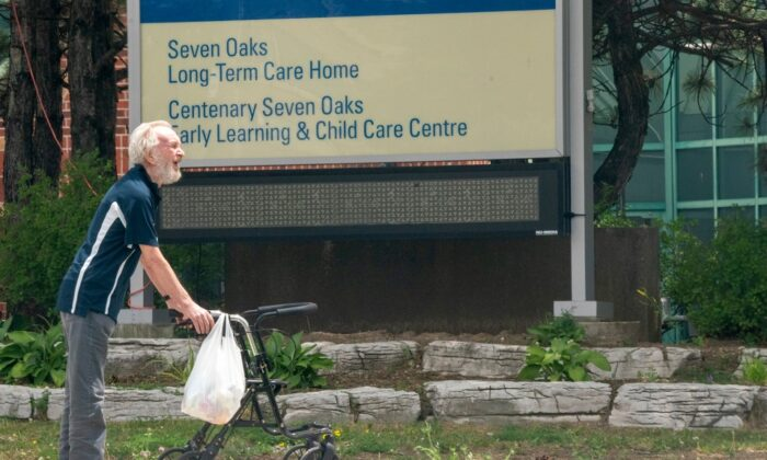 A man takes a walk outside the Seven Oaks Long-Term Care Home in Toronto on June 25, 2020. (The Canadian Press/Frank Gunn)