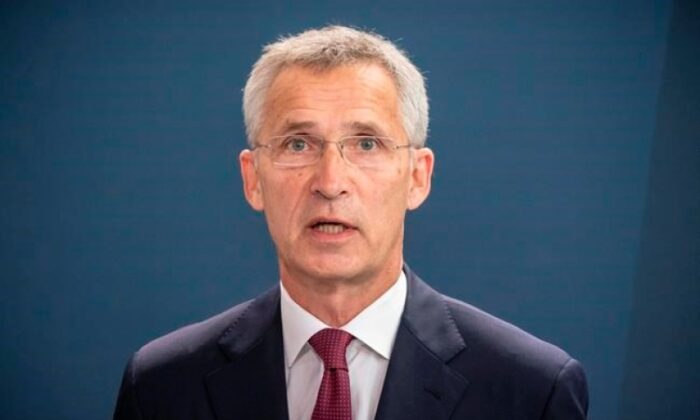 NATO Secretary-General Jens Stoltenberg talks to the media after a meeting with German Chancellor Angela Merkel in the Chancellery in Berlin, Germany, on Aug. 27, 2020. (THE CANADIAN PRESS/Michael Kappeler/Pool via AP)