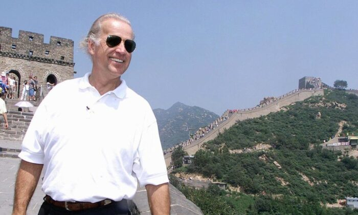 Then-U.S. Senate Foreign Relations Committee Chairman Joe Biden visits the Great Wall of China at Badaling, north of Beijing, on Aug. 10, 2001. (Greg Baker/POOL/AFP via Getty Images)