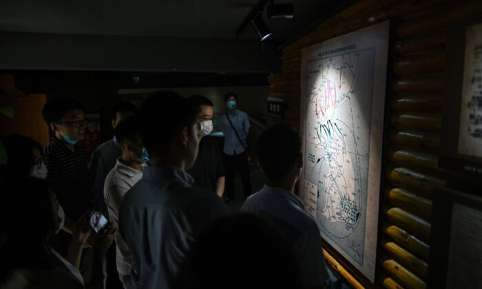 Chinese people look at a map of the Korean peninsula at Chinese People's Volunteer Army Commemorative Museum in Shanghai, China on June 17, 2020. (HECTOR RETAMAL/AFP via Getty Images)