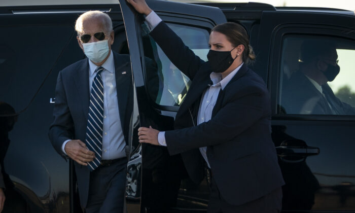 Democratic presidential nominee Joe Biden arrives to board his campaign plane at Raleigh-Durham International Airport in Morrisville, N.C., on Oct. 18, 2020. (Drew Angerer/Getty Images)