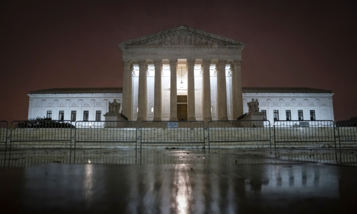 The Supreme Court is illuminated in Washington on Oct. 12, 2020. (Drew Angerer/Getty Images)