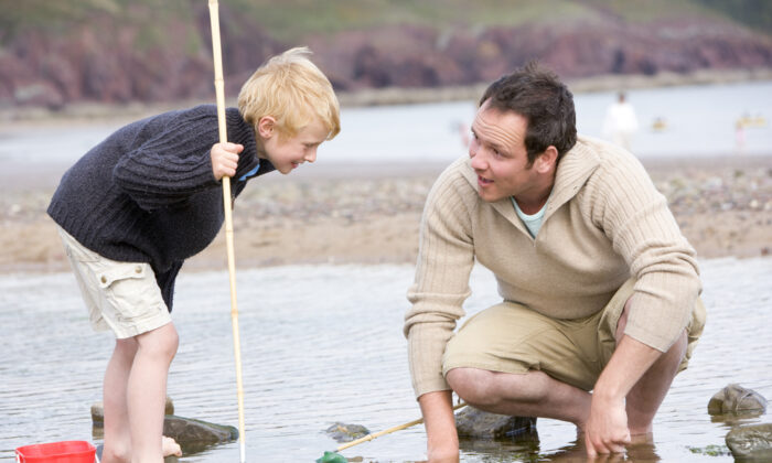 Father and son fish at the beach. (Monkey Business Images/Shutterstock)