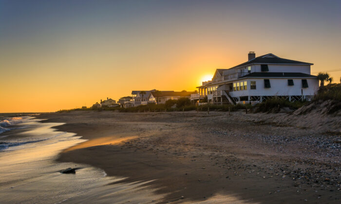 Sunset over beach homes in Edisto Beach, S.C. (Jon Bilous/Shutterstock)