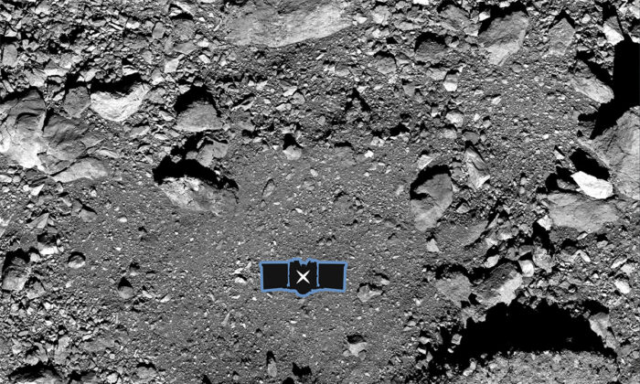 """This undated image made available by NASA shows the OSIRIS-REx spacecraft's primary sample collection site, named """"Nightingale,"""" on the asteroid Bennu. After almost two years circling the ancient asteroid the spacecraft descended to the surface and snatched a handful of rubble on Oct. 21, 2020. (NASA/Goddard/University of Arizona via AP)"""