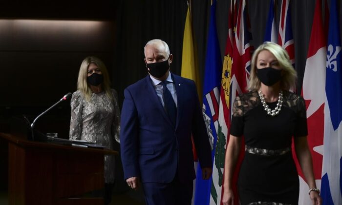 Conservative member of Parliament Michelle Rempel Garner (L to R) and Conservative leader Erin O'Toole and Conservative member of Parliament Candice Bergen arrive to hold a press conference in Ottawa, on Oct. 22, 2020. (The Canadian Press/Sean Kilpatrick)