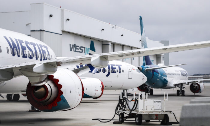 Grounded WestJet Boeing 737 Max aircraft are shown at the airline's facilities in Calgary on May 7, 2019. WestJet Airlines Ltd. has quietly changed its refund policy to allow some customers whose flights were cancelled due to the pandemic to reclaim their cash. (The Canadian Press/Jeff McIntosh)