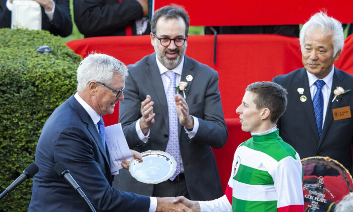 (Center) Racing Minister Martin Pakula, (Right) Damian Lane, is congratulated at a trophy presentation after winning race 9 the Ladbrokes Cox Plate on Lys Gracieux during Cox Plate Day at Moonee Valley Racecourse in Melbourne, Australia on Oct. 26, 2019. (Jenny Evans/Getty Images)