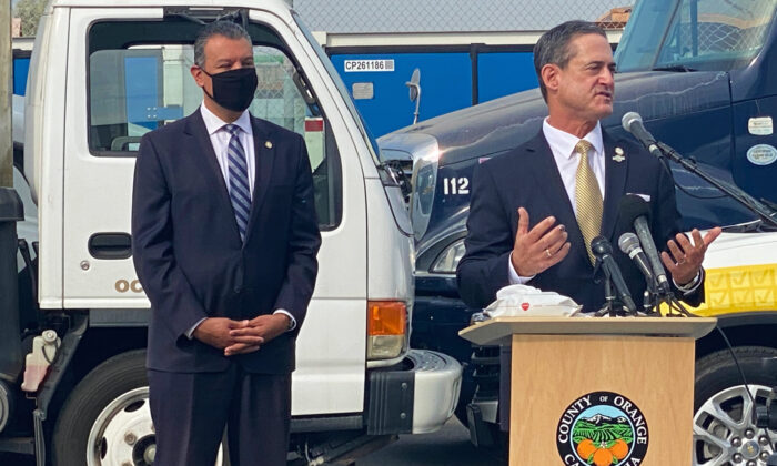 Orange County District Attorney Todd Spitzer (R) speaks while California Secretary of State Alex Padilla listens at an event discussing election integrity outside the Orange County Registrar's office in Santa Ana, Calif., on Oct. 5, 2020. (Jamie Joseph/The Epoch Times)