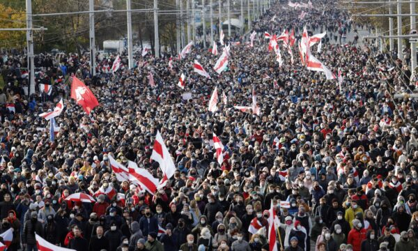 People with old Belarusian national flags march