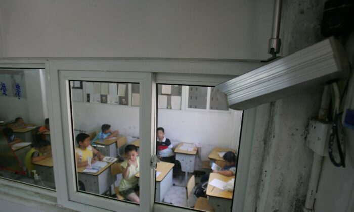 A camera records the activities in a classroom at a university in Hangzhou, Zhejiang Province of China, on Aug. 1, 2006. (Cancan Chu/Getty Images)