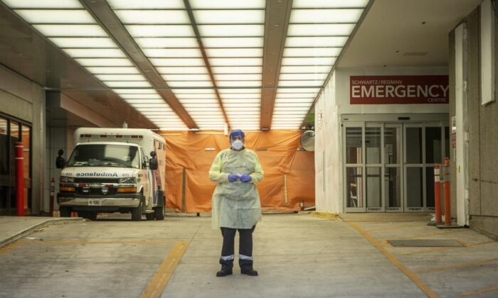 A paramedic stands in the ambulance bay of Mount Sinai Hospital in Toronto, on June 6, 2020. (The Canadian Press/Chris Young)