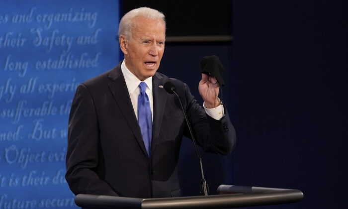 Democratic presidential candidate former Vice President Joe Biden holds up a mask during the second and final presidential debate in Nashville, Tenn., on Oct. 22, 2020. (Morry Gash, Pool/AP Photo)