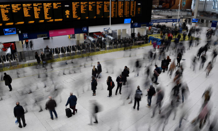 File photo shows workers arriving during the morning rush hour at Waterloo Station in London on March 4, 2020. (Toby Melville/Reuters)
