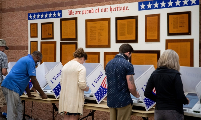 Voters cast their ballots at an early vote location at the Charleston Coliseum and Convention Center in North Charleston, S.C., on Oct. 16, 2020. (Logan Cyrus/AFP via Getty Images)