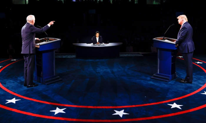 President Donald Trump (R), Democratic Presidential candidate former Vice President Joe Biden, and moderator NBC News anchor Kristen Welker (C) participate in the final presidential debate at Belmont University in Nashville, Tennessee, on Oct. 22, 2020. (Jim Bourg/Pool/AFP via Getty Images)