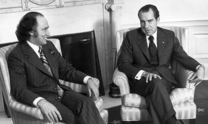President Richard Nixon, right, consults Canadian Prime Minister Pierre Trudeau on Nixon's trip to Communist China, at the White House in Washington in Dec. 12, 1971. (Hulton Archive/Getty Images)