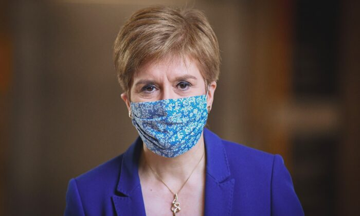 Scotland's First Minister Nicola Sturgeon wears a protective face covering as she arrives for First Minister's Questions at the Scottish Parliament, in Edinburgh, Scotland, on Oct. 8, 2020.  (Jeff J Mitchell/POOL/AFP via Getty Images)