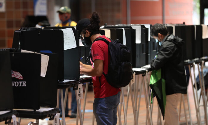 Voters fill out their ballots as they vote at the Stephen P. Clark Government Center polling station on Oct. 21, 2020 in Miami, Fla. (Joe Raedle/Getty Images)