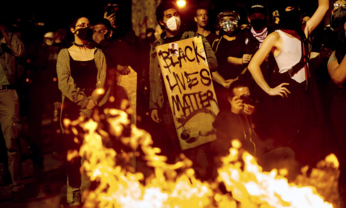 A Black Lives Matter protester seen at a riot in Portland, Ore., on Aug. 1, 2020. (Noah Berger/AP Photo)