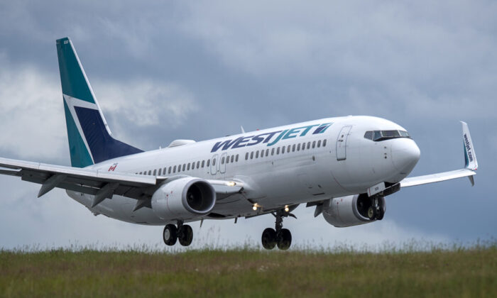 A WestJet flight from Calgary arrives at Halifax Stanfield International Airport in Enfield, N.S., on July 6, 2020. (Andrew Vaughan/The Canadian Press)