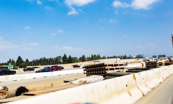 Construction materials line the I-405 freeway in Costa Mesa, Calif., on Oct. 22, 2020. (John Fredricks/The Epoch Times)
