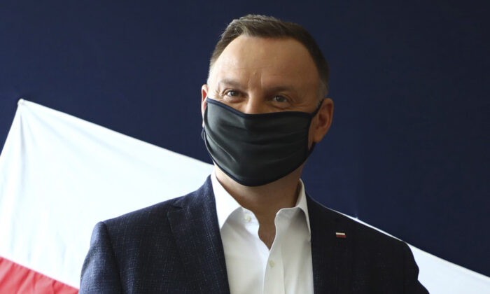 Poland's President Andrzej Duda casting his vote during presidential election in Krakow, Poland on June 28, 2020. (Beata Zawrzal/AP Photo, file)