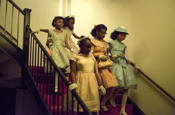 "Five little black girls descending staircase in ""Selma"""