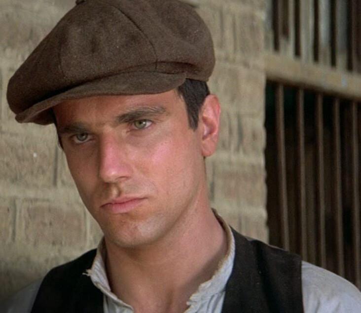 "man in brown hat and vest in ""Gandhi"""