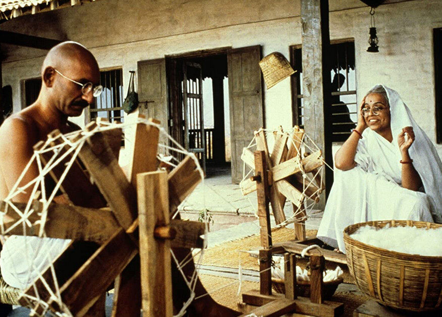 """man and woman spinning wool in """"Gandhi"""""""