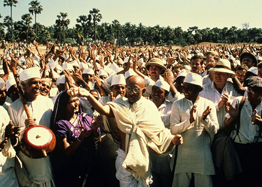 "man in white holds handful of salt in ""Gandhi"""