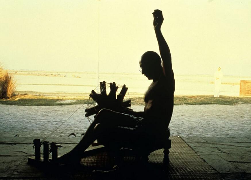 "silhouette of man spnning wool in ""Gandhi"""
