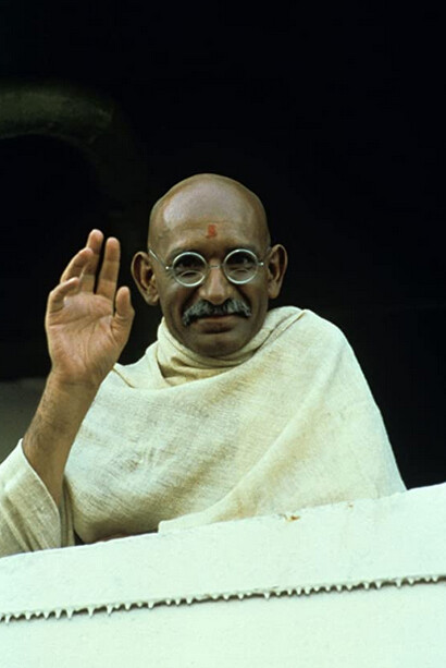 """man with white shawl and round glasses in """"Gandhi"""""""