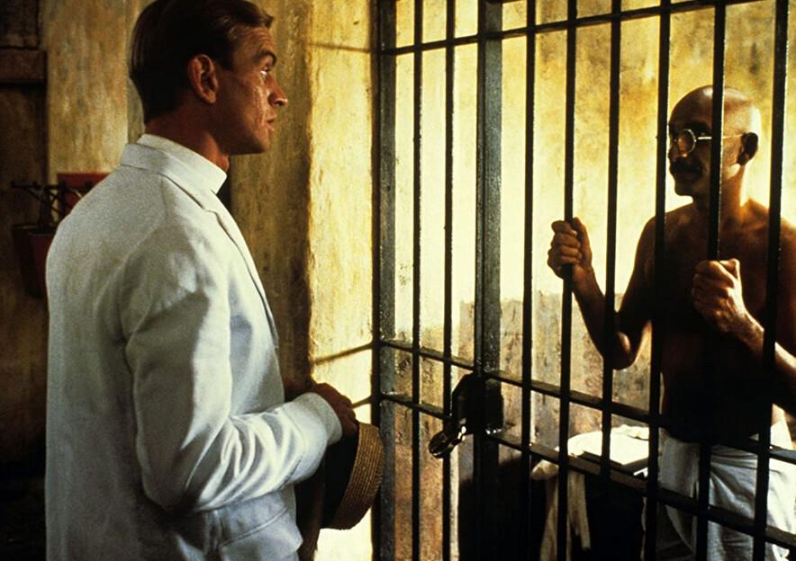 "man in white suit visits man in prison in ""Gandhi"""