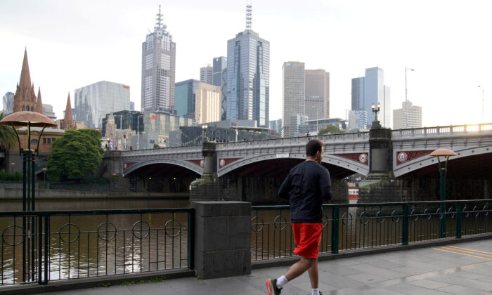 A man runs along a waterway amid lockdown restrictions in Melbourne, Australia, on July 10, 2020.  (Sandra Sanders/Reuters)