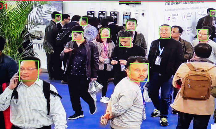 A screen shows visitors being filmed by AI (artificial intelligence) security cameras with facial recognition technology at the 14th China International Exhibition on Public Safety and Security at the China International Exhibition Center in Beijing on Oct. 24, 2018. (Photo by NICOLAS ASFOURI / AFP) (Photo by NICOLAS ASFOURI/AFP via Getty Images)