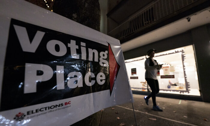 A voter is seen as she takes part at an advanced polling station in North Vancouver, B.C., on Oct. 20, 2020.  (The Canadian Press/Jonathan Hayward)