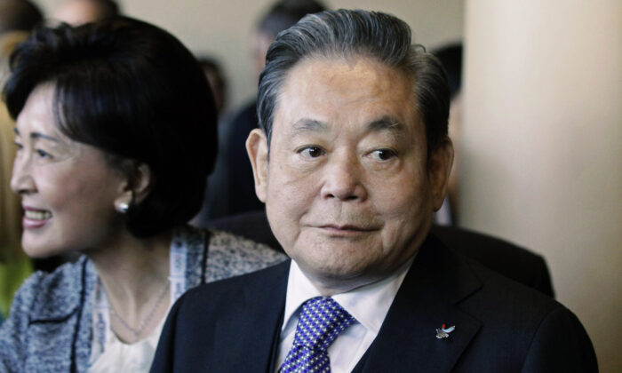 Samsung Chairman Lee Kun-hee (R) greets people from the South Korean delegation in Durban, South Africa, for the 123rd International Olympic Committee (IOC) session that will decide the host city for the 2018 Olympics Winter Games, on July 6, 2011. (Schalk van Zuydam/AP Photo)